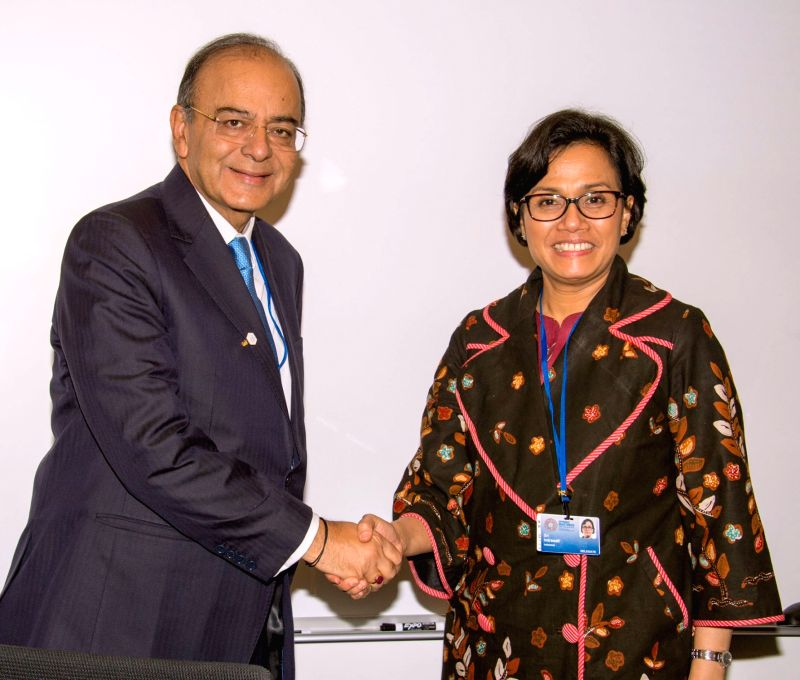 Washington D.C.: Union Minister for Finance, Corporate Affairs and Defence Arun Jaitley in a bilateral meeting with the Indonesian Finance Minister Mulyani Indrawati, on the sidelines of the Spring ... - Mulyani Indrawati and Arun Jaitley