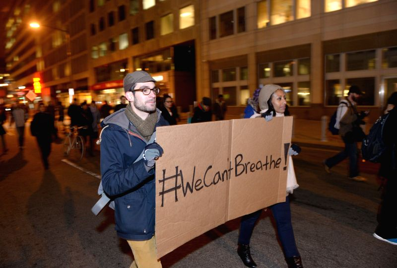 Washington DC. : People attend a demonstration protesting against a grand jury's decision not to indict a white police officer in the chokehold death of black man Eric Garner in Washington D.C., the .