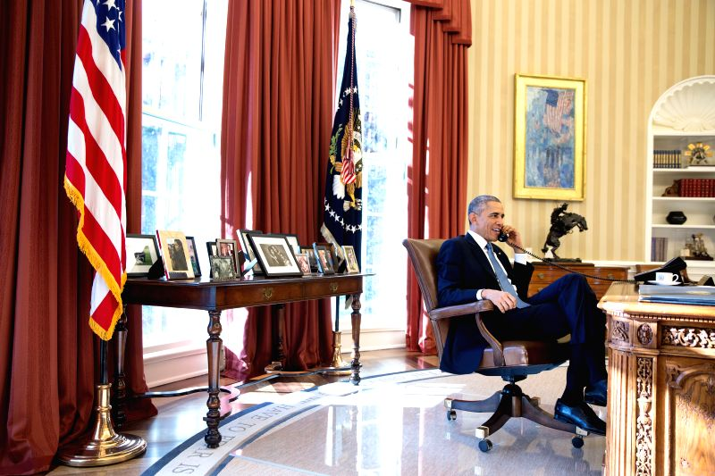 Photo released by the White House shows U.S. President Barack Obama talking on the phone with Alan Gross who was en route to the U.S. from Cuba after being ...