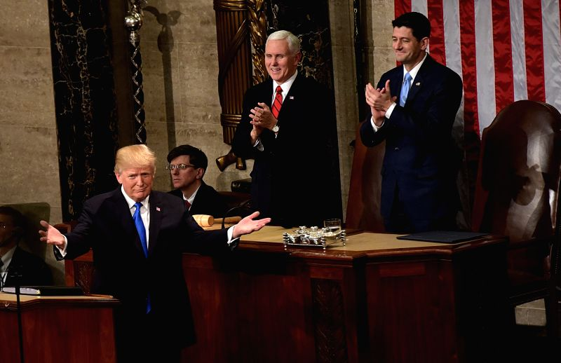 WASHINGTON, Jan. 31, 2018 - U.S. President Donald Trump(L) delivers his State of the Union address to a joint session of Congress on Capitol Hill in Washington D.C., the United States, Jan. 30, 2018.