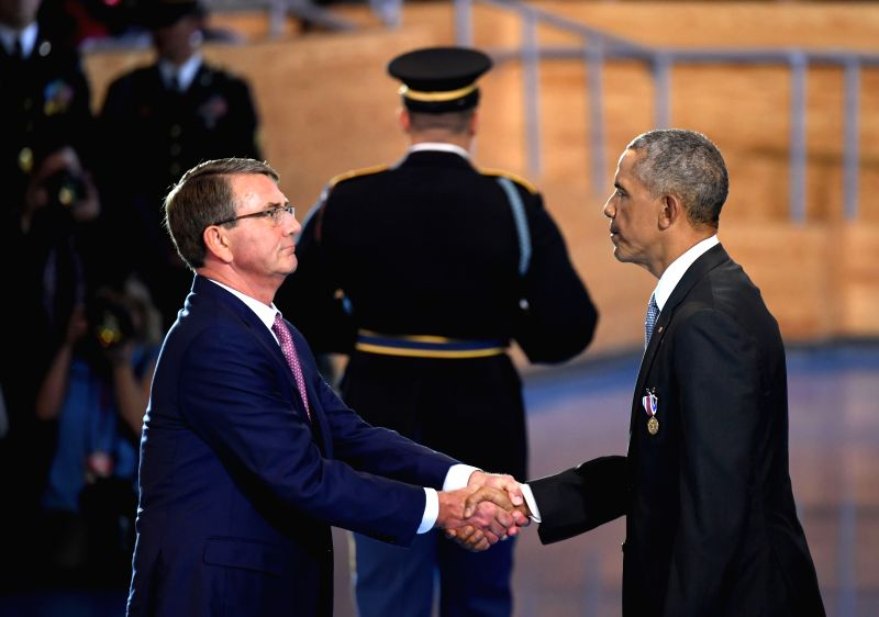 WASHINGTON, Jan. 4, 2017 - U.S. President Barack Obama(R) shakes hands with Defense Secretary Ash Carter during an Armed Forces Full Honor Farewell Ceremony for the president at Joint Base ...