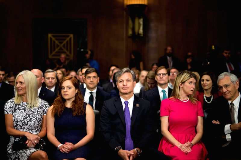 WASHINGTON, July 12, 2017 - Christopher A. Wray (C) is seen with his family before the Senate Judiciary Committee hearing on his nomination to be the new Director of the Federal Bureau of ...