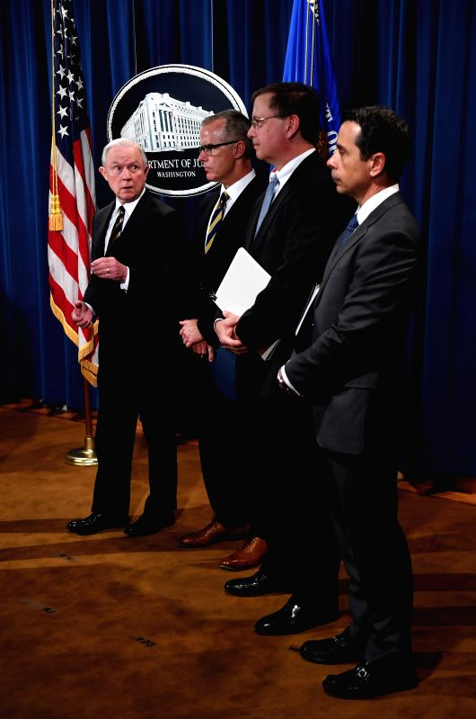 WASHINGTON, July 14, 2017 - U.S. Attorney General Jeff Sessions (1st L) attends a news conference at the Department of Justice in Washington D.C. July 13, 2017. A total of 412 people, who were ...