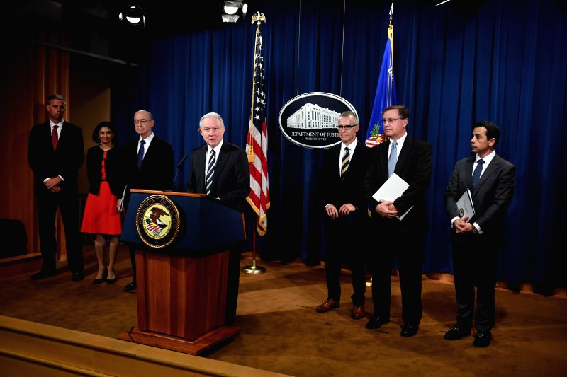 WASHINGTON, July 14, 2017 - U.S. Attorney General Jeff Sessions (C) addresses a news conference at the Department of Justice in Washington D.C. July 13, 2017. A total of 412 people, who were ...
