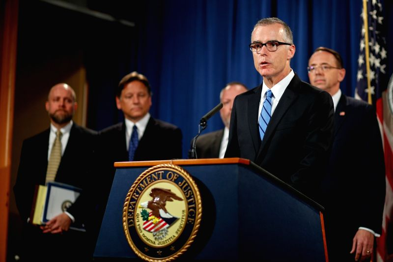 WASHINGTON, July 20, 2017 - Andrew McCabe (Front), U.S. acting director of the Federal Bureau of Investigation, attends a press conference at the U.S. Justice Department in Washington D.C., the ...