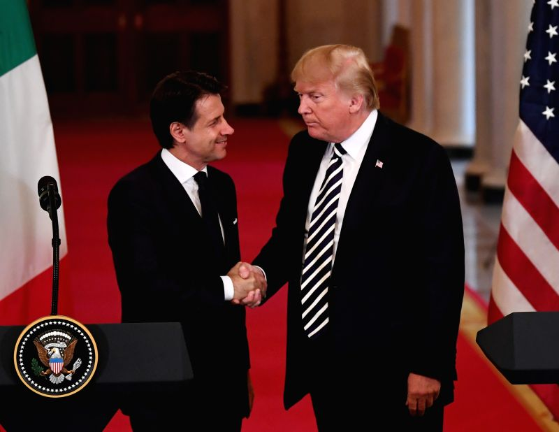 WASHINGTON, July 30, 2018 - U.S. President Donald Trump (R) shakes hands with Italian Prime Minister Giuseppe Conte during a joint press conference at the White House in Washington D.C., the United ... - Giuseppe Conte and Hassan Rouhani