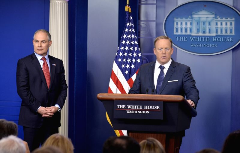 WASHINGTON, June 2, 2017 - U.S. Environmental Protection Agency administrator Scott Pruitt (L) and White House spokesman Sean Spicer attend a press briefing about President Donald Trump's decision to ...