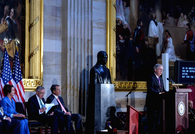 Republican Mitch McConnell, minority leader of the US Senate, addresses the ceremony marking the 50th anniversary of the Civil Rights Act of 1964 at the Capitol .