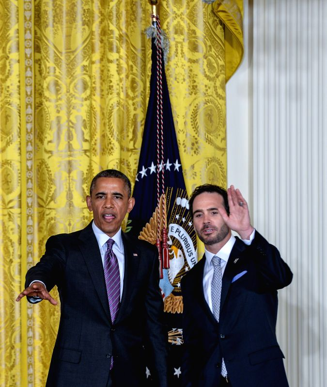 U.S. President Barack Obama (L) hosts Jimmie Johnson and the Hendrick Motorsports team members and honors their 2013 NASCAR Sprint Cup Series Championship at the