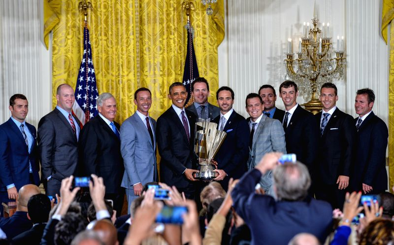 U.S. President Barack Obama (5th L) poses with Jimmie Johnson (6th R) and the Hendrick Motorsports team members and honors their 2013 NASCAR Sprint Cup Series ...