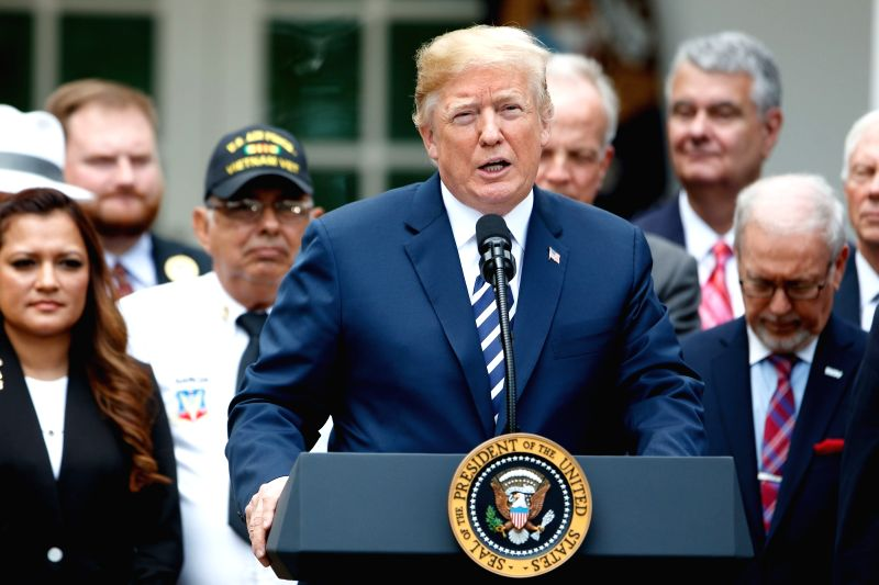 "WASHINGTON, June 6, 2018 - U.S. President Donald Trump (Front) speaks during a bill signing ceremony for the ""VA Mission Act of 2018"" in the Rose Garden of the White House in Washington ..."