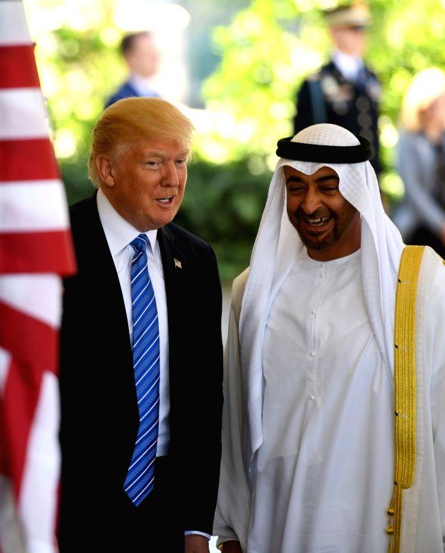 WASHINGTON, May 15, 2017 - U.S. President Donald Trump (L) welcomes Sheikh Mohamed bin Zayed Al-Nahyan, Abu Dhabi Crown Prince of the United Arab Emirates (UAE), at the White House in Washington ...