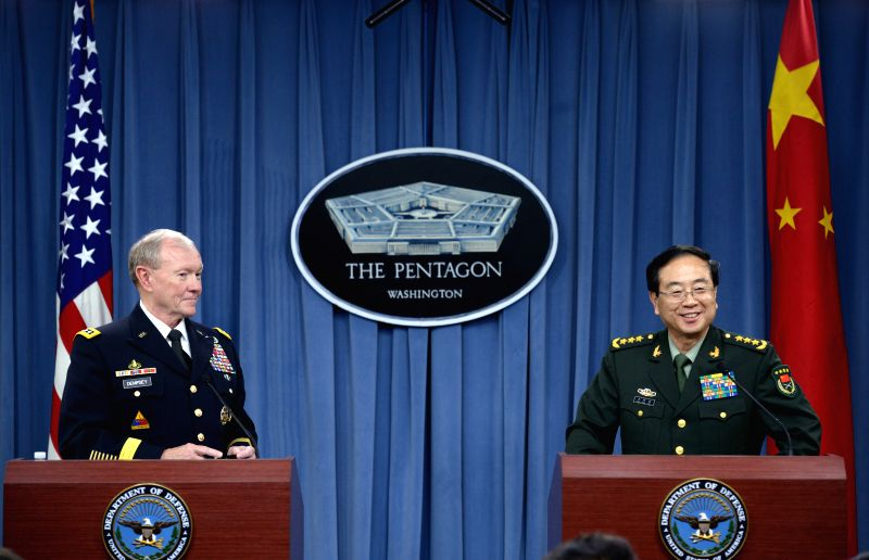 Chairman of the Joint Chiefs of Staff Army Martin Dempsey (L) and Fang Fenghui, chief of the General Staff of the People's Liberation Army of China, attend a ...