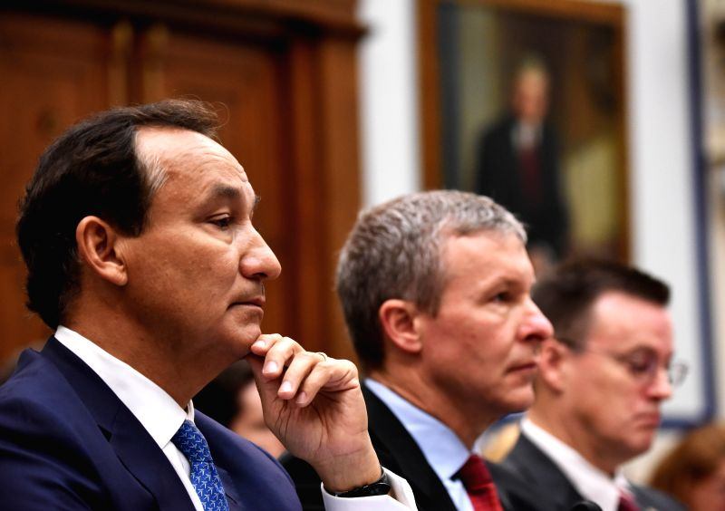 WASHINGTON, May 2, 2017 - United CEO Oscar Munoz (1st L) prepares to testify before the House Transportation and Infrastructure Committee on customer service policies on Capitol Hill in Washington ...