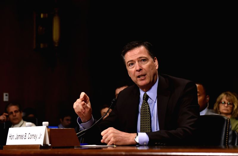 WASHINGTON, May 9, 2017 - File photo taken on May 3, 2017 shows that James Comey, the director of Federal Bureau of Investigation (FBI), testifies before the Senate Judiciary Committee during a ...