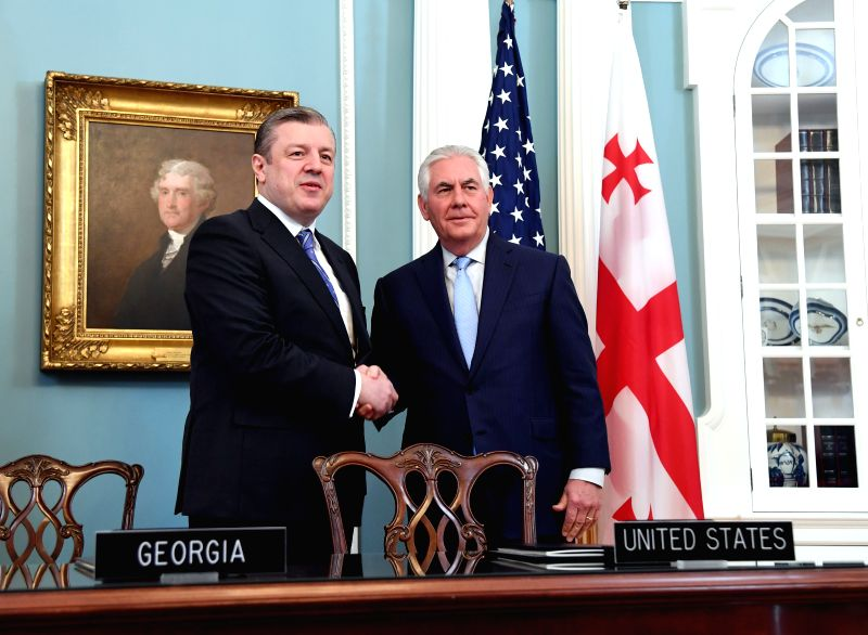 WASHINGTON, May 9, 2017 - U.S. Secretary of State Rex Tillerson (R) shakes hands with Georgian Prime Minister Giorgi Kvirikashvili after signing documents of the U.S.-Georgia General Security of ... - Giorgi Kvirikashvili