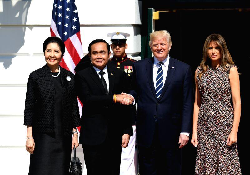 WASHINGTON, Oct. 2, 2017 - U.S. President Donald Trump (2nd R) greets Thai Prime Minister Prayuth Chan-ocha (2nd L) at the White House in Washington D.C., the United States, on Oct. 2, 2017. Prayuth ... - Prayuth Chan
