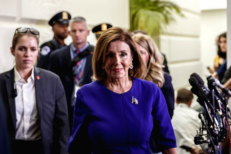 WASHINGTON, Sept. 24, 2019 (Xinhua) -- U.S. House Speaker Nancy Pelosi (front) walks to her office on Capitol Hill in Washington D.C., the United States, on Sept. 24, 2019. Nancy Pelosi announced Tuesday the initiation of a formal impeachment inquiry