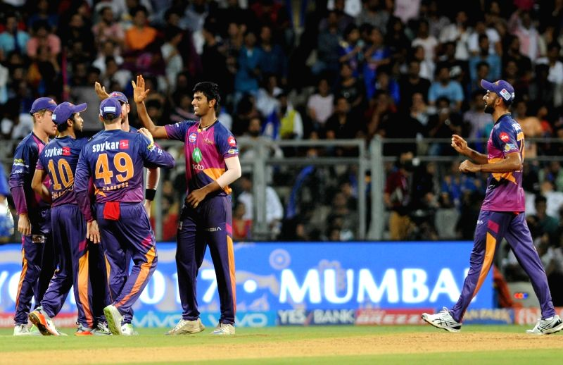 Washington Sundar of Rising Pune Supergiant celebrates fall of  Steven Smith's wicket during the first qualifier of IPL 2017 between Mumbai Indians and Rising Pune Supergiant at Wankhede ...