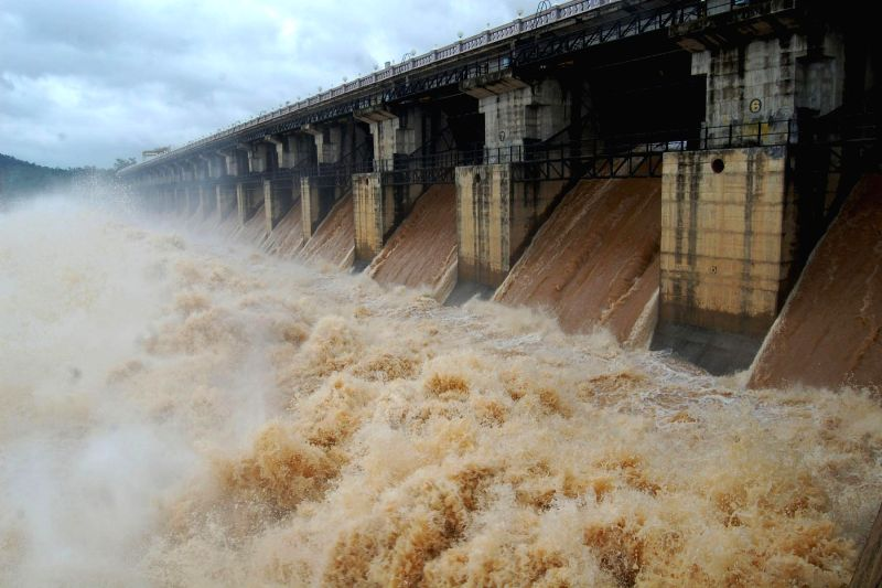 Water being released from Gajanur Dam after heavy rains in Shimoga of Karnataka on July 18, 2014. The dam is built on Tunga river.