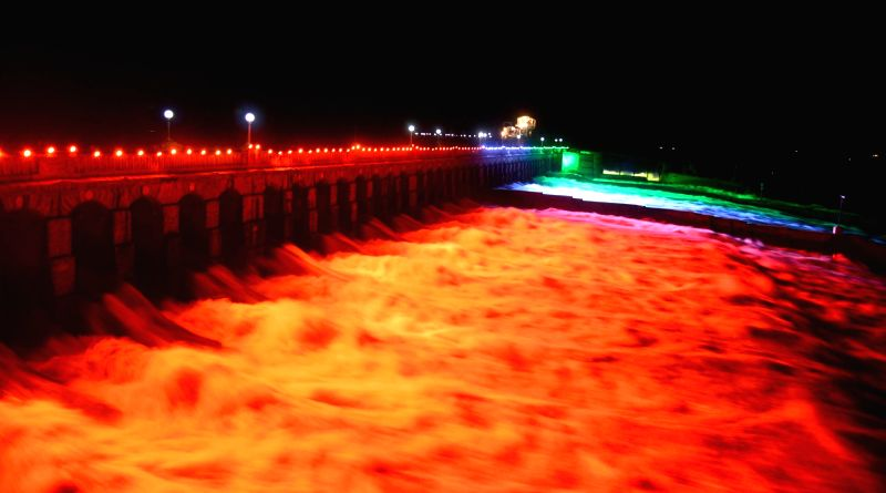 Water gets released from an illuminated Krishnaraja Sagar (KRS) reservoir to River Cauvery in Mysuru on July 18, 2018.