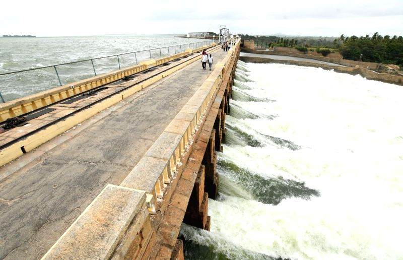 Water gets released from Krishnaraja Sagar (KRS) reservoir after the water level reached 120 feet after heavy rains continue in Cauvery catchment areas, in Mysuru on July 13, 2018.
