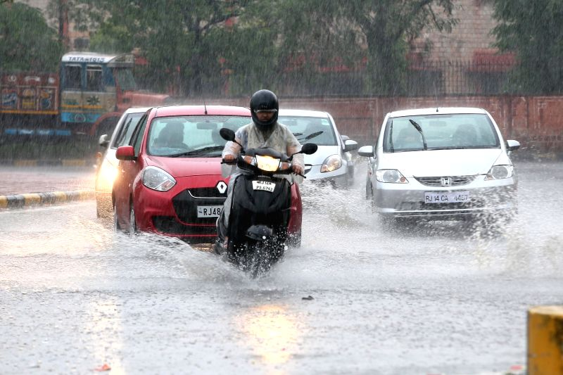 Water inundates Jaipur roads after heavy rains lash the Pink City on July 17, 2015.