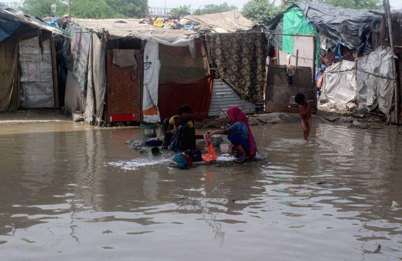 Water inundates low lying areas near Yamuna in New Delhi on July 30, 2018.