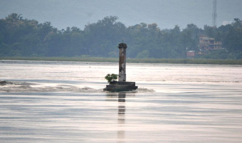 Water level of Brahmaputra river rose by 2 cms in 12 hours, in Guwahati on Aug 24, 2014.