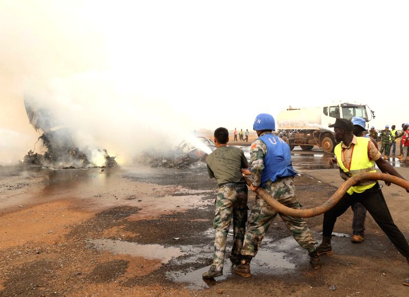 WAU (SOUTH SUDAN), March 21, 2017 Chinese peacekeepers participate in rescue work in Wau Airport, South Sudan, on March 20, 2017. All 43 passengers and six crew members have survived the ...