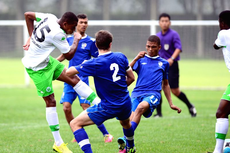 Anton Donkor (L) of VfL Wolfsburg shoots during the match between VfL Wolfsburg and Western Cape at the Weifang Cup International Youth Football Tournament in ...
