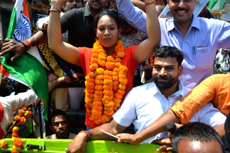 Weightlifter Punam Yadav who won gold medal at 21st Commonwealth Games 2018 at the Gold Coast in Australia, being welcomed on her arrival in Varanasi on March 13, 2018. Punam in the 69kg ... - Punam Yadav