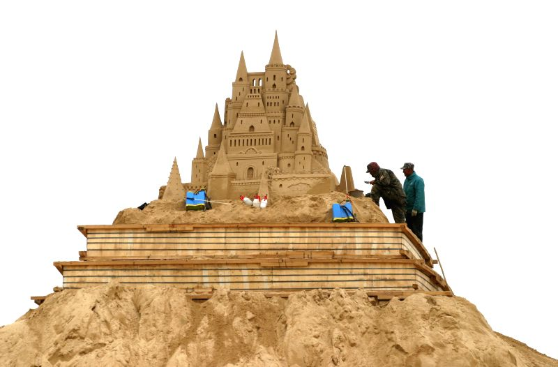 "An artist creates sand sculpture ""Lion King"" on a seashore in Weihai, east China's Shandong Province, April 26, 2014."