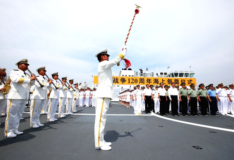 A ceremony is held to commemorate the 120th anniversary of the First Sino-Japanese War of 1894-1895 on a ship in a port of Weihai, east China's Shandong Province, ...