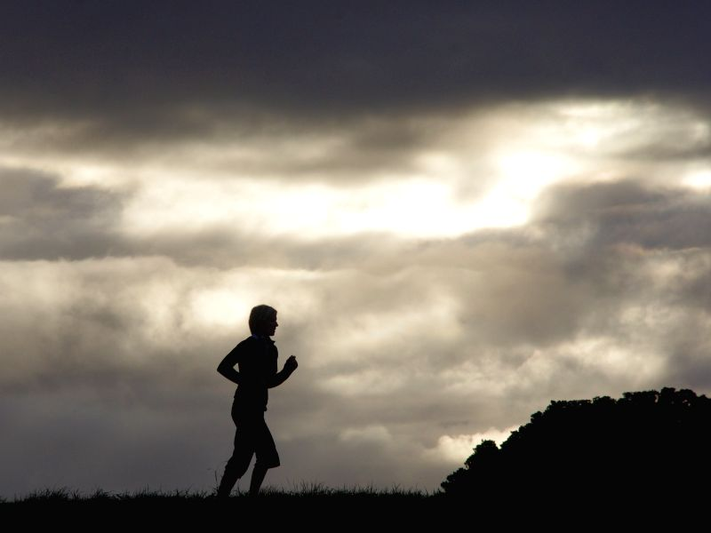 A woman joins morning running in Lower Hutt, a small suburb city near Wellington, New Zealand, May 10, 2014.