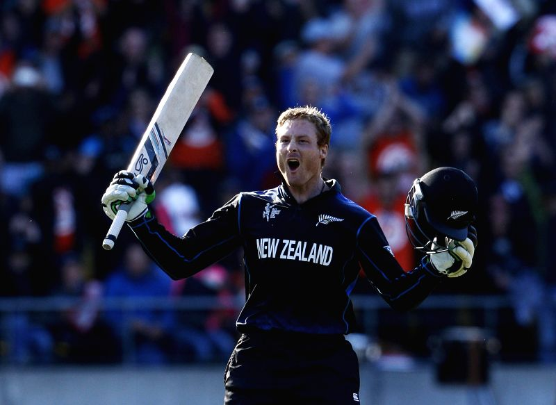 Wellington (New Zealand): New Zealand batsman Martin Guptill celebrates after scoring double century during the ICC World Cup - 2015 quarter-final match between New Zealand and West Indies at Westpac ... - Martin Guptill