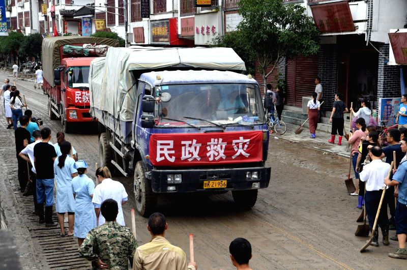 WENXIAN, July 13, 2018 - Vehicles carrying relief materials arrive at flood-hit Bikou Township in Wenxian County, northwest China's Gansu Province, July 13, 2018. China's disaster relief authorities ...
