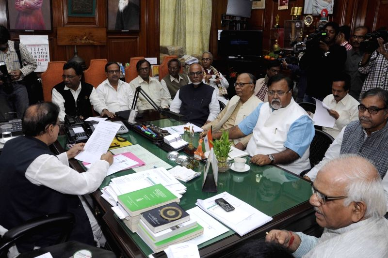 West Bengal Assembly Speaker Biman Banerjee holds an all party meeting ahead of the winter session in Kolkata, on Dec 7, 2015. Also seen West Bengal Minister Partha Chatterjee. - Biman Banerjee and Partha Chatterjee