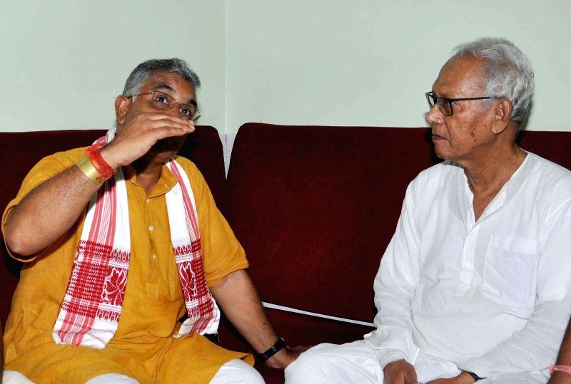 West Bengal BJP chief Dilip Ghosh meets writer Sunanda Sanwal at his residence in Kolkata, on June 8, 2017. - Dilip Ghosh