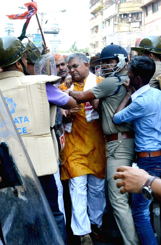 West Bengal BJP chief Dilip Gosh being taken away by police during a protest against the law and order situation in the state and fake cases lodged against BJP workers among other issues in ...
