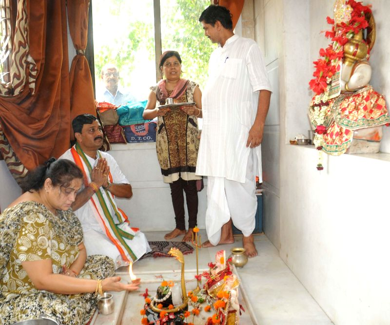 West Bengal BJP president and party's candidate for 2014 Lok Sabha Election from North Kolkata parliamentary constituency Rahul Sinha offers 'puja' ahead of 2014 Lok Sabha Elections in Kolkata on ...