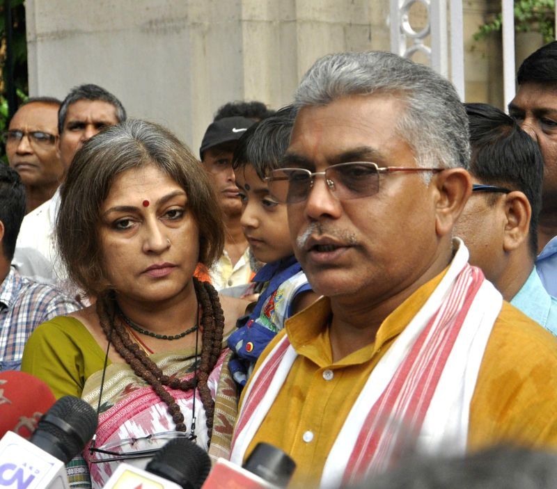West Bengal BJP president Dilip Ghosh talks to press after meeting with West Bengal Governor Keshari Nath Tripathi at Raj Bhawan in Kolkata on June 7, 2017. Also seen BJP leader Roopa ... - Dilip Ghosh and Keshari Nath Tripathi
