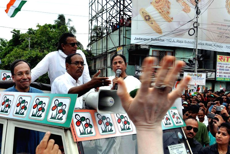 West Bengal Chief Minister and TMC supremo Mamata Banerjee with actor Mithun Chakrabarty campaigning in support of Jadavpur and South Kolkata parliamentary constituency TMC candidate Sugata Basu and . - Sugata Basu and Subrata Bakshi