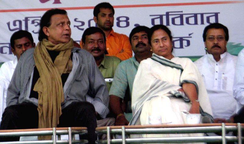 West Bengal Chief Minister and Trinamool Congress supremo Mamata Banerjee with Rajya Sabha member and actor Mithun Chakraborty during a rally in Siliguri of West Bengal on April 13, 2014.