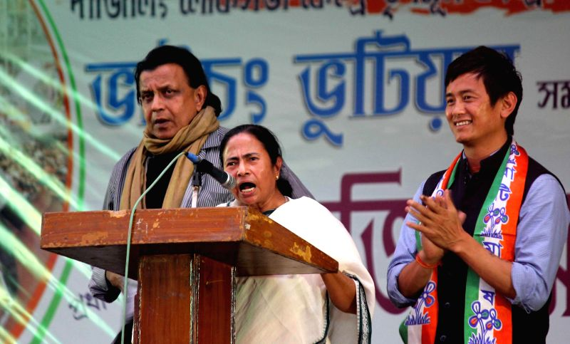 West Bengal Chief Minister and Trinamool Congress supremo Mamata Banerjee with Rajya Sabha member and actor Mithun Chakraborty and Trinamool Congress candidate for upcoming 2014 Lok Sabha Elections ..