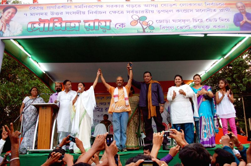 West Bengal Chief Minister and Trinamool Congress supremo Mamata Banerjee  with actor Mithun Chakraborty, party leader Mukul Roy, Soumitra Roy and others during a rally in Malda on April 16, 2014. - Mithun Chakraborty, Mamata Banerjee, Mukul Roy and Soumitra Roy