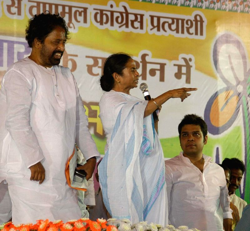 West Bengal Chief Minister and Trinamool Congress supremo Mamata Banerjee with North Kolkata parliamentary constituency, Sudip Banerjee during an election campaign in Kolkata on April 29, 2014. - Sudip Banerjee