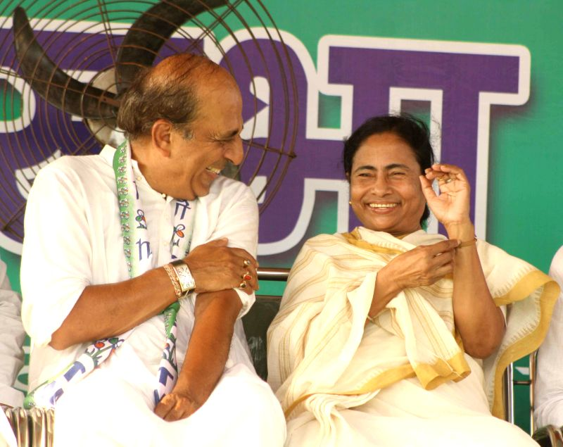 West Bengal Chief Minister and Trinamool Congress supremo Mamata Banerjee with Trinamool Congress candidate for 2014 Lok Sabha Election from Barrackpore, Dinesh Trivedi during a rally in Titagarh of . - Mamata Banerjee