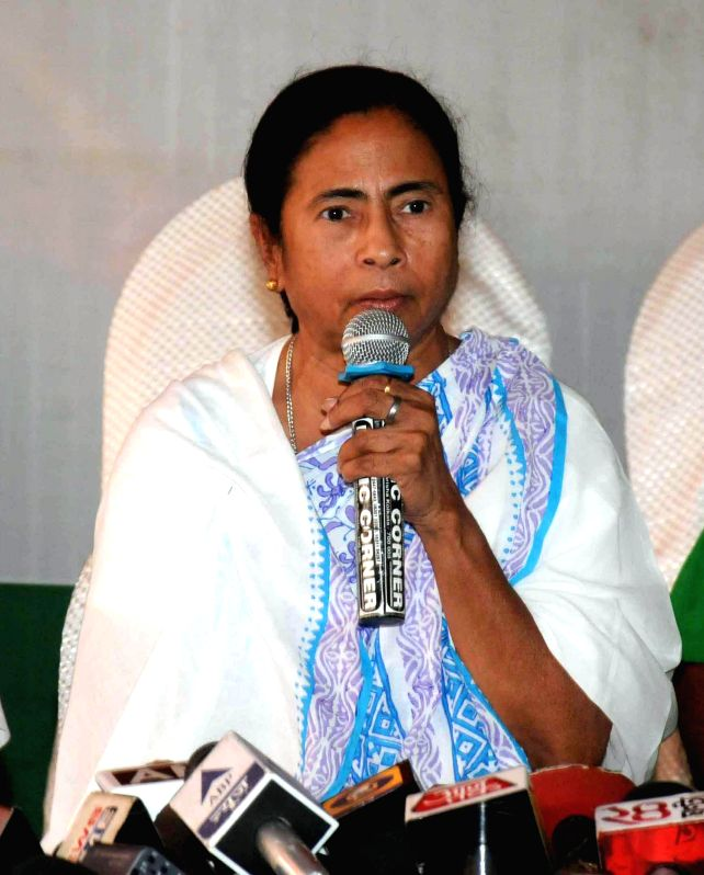 West Bengal Chief Minister and Trinamool Congress supremo Mamata Banerjee addresses a press conference in Kolkata on May 16, 2014. - Mamata Banerjee