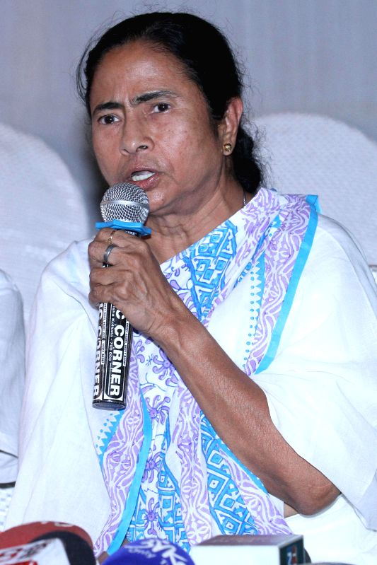 West Bengal Chief Minister and Trinamool Congress supremo Mamata Banerjee addresses a press conference in Kolkata on May 16, 2014.